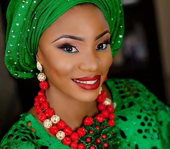 Check Out This Green Monotone Bridal Look With Alluring Red Accessories