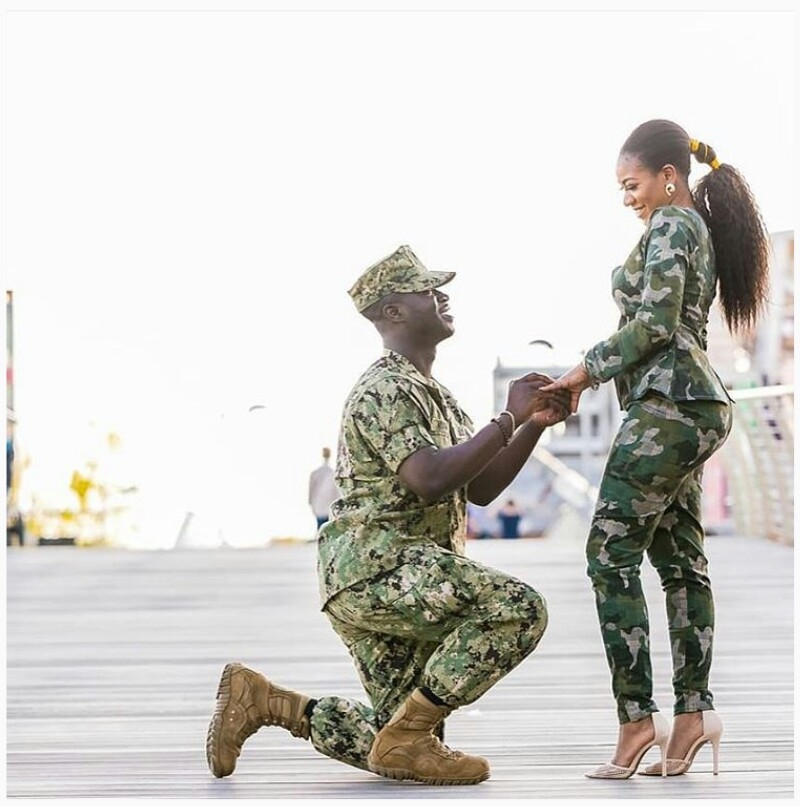 Man propose to his girlfriend wearing army camouflage